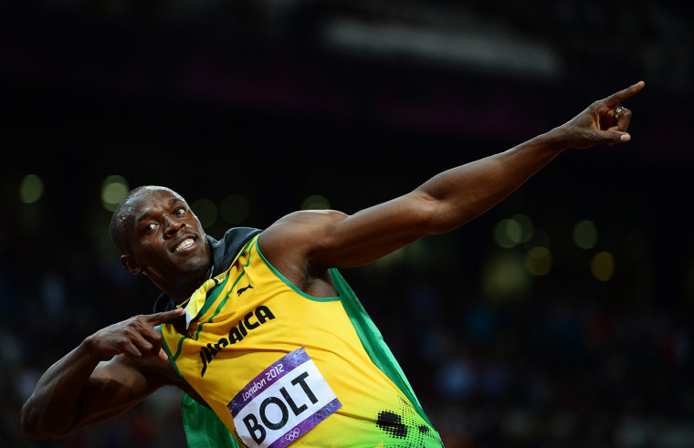 Image: Jamaica's Usain Bolt celebrates after winning the men's 100m final at the athletics event during the London 2012 Olympic Games