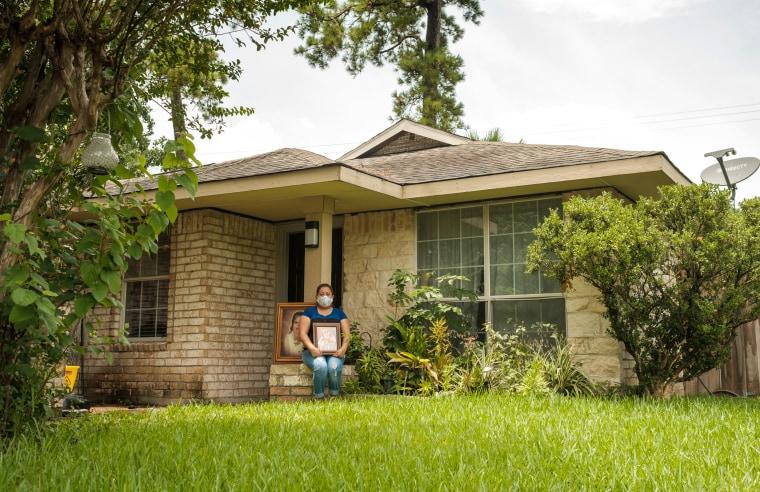 Karen Salazar holds a photo of her mother, Felipa Medell?n, outside of her mother's home in Houston on July 7, 2020.