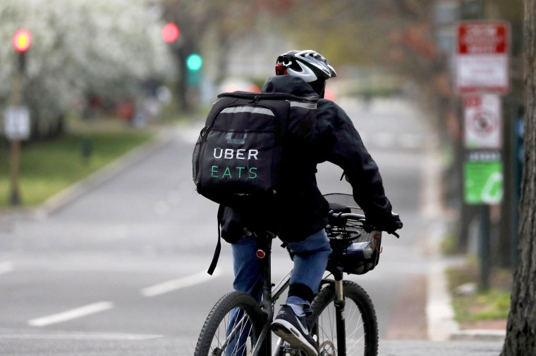 Image: FILE PHOTO: An Uber Eats bicyclist makes a delivery during the coronavirus outbreak, in the U.S. Capitol Hill neighborhood in Washington