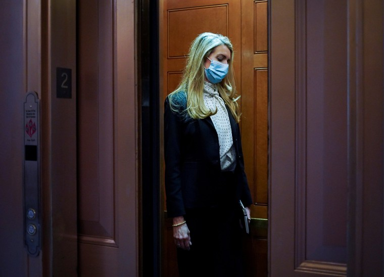 Image: Sen. Kelly Loeffler, R-Ga., leaves following a vote at the Capitol
