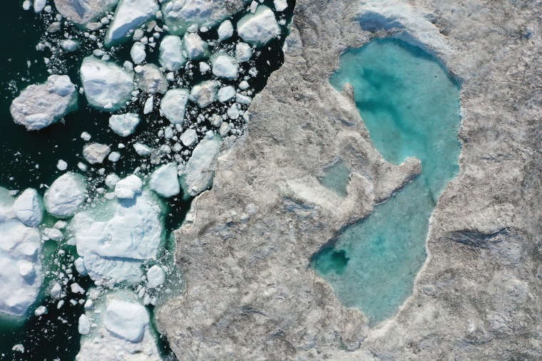 Melting ice forms a lake on free-floating ice jammed into the Ilulissat Icefjord during unseasonably warm weather near Ilulissat, Greenland, on July 30, 2019.
