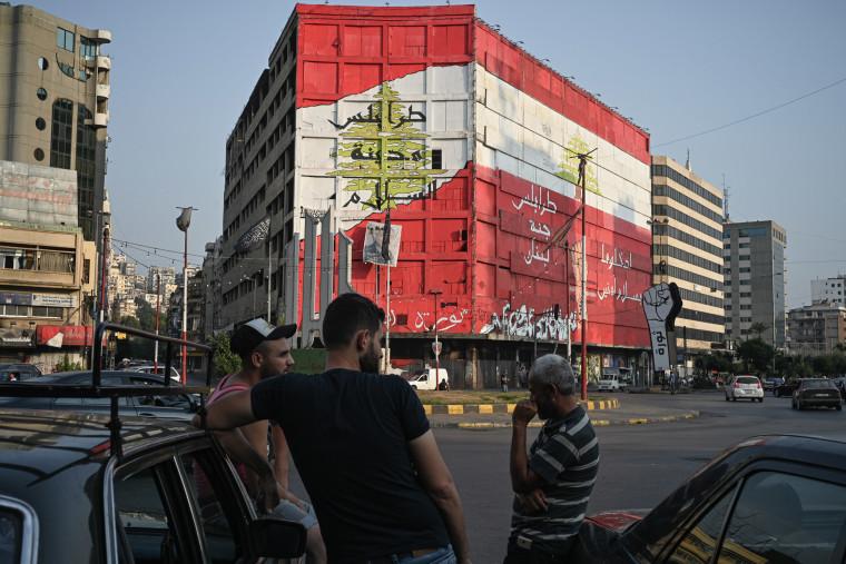 Image: Taxi drivers wait for a fare in Tripoli's al-Nour Square.
