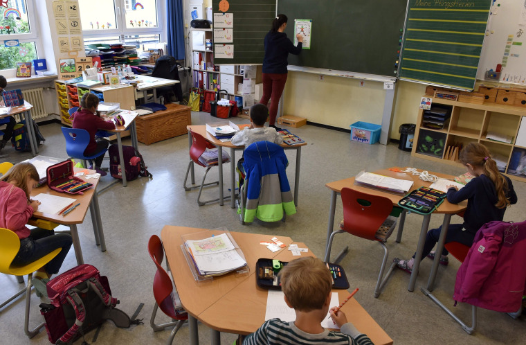 Image: Students sit in a classroom at a primary school in Eichenau, southern Germany,