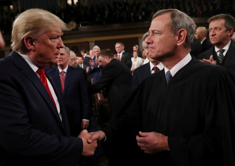 President Donald Trump greets Supreme Court Chief Justice John Roberts as he arrives to deliver his State of the Union address in Washington, D.C., on Feb. 4, 2020.