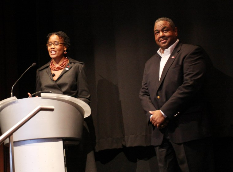 New York Urban League president Arva Rice and Herman Lessard attend Stronger: Girls' Empowerment Day at the Time Warner Center on May 7, 2010 in New York City.