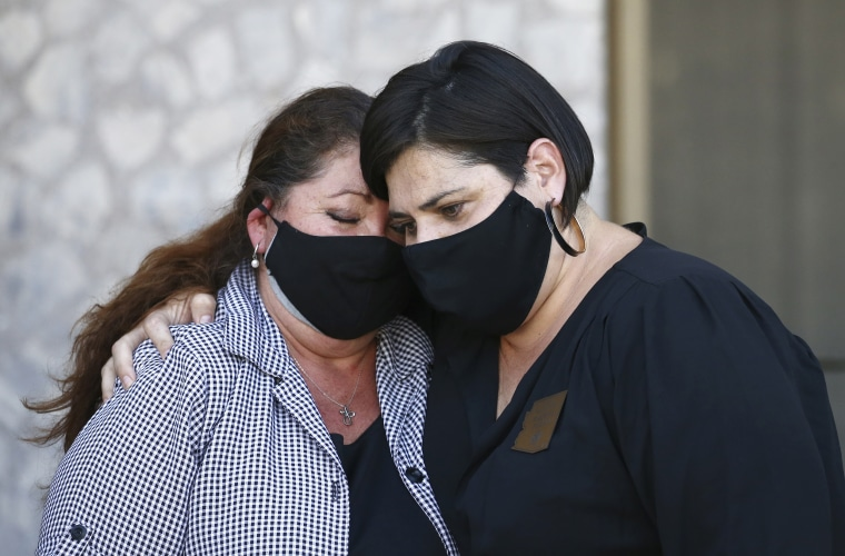 Denice Garcia, left, mother of James Garcia, who was shot last week by Phoenix police, is comforted by state Rep. Raquel Teran, D-Phoenix, during a news conference demanding the release of police body cam footage on July 8, 2020, in Phoenix, in the police shooting death of 28-year-old Garcia.
