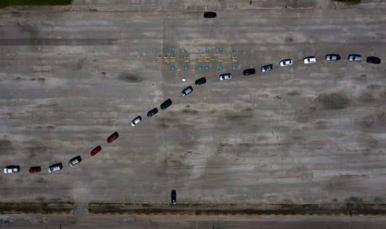 Image: Residents wait in their cars at a COVID-19 testing site in Houston on July 9, 2020.