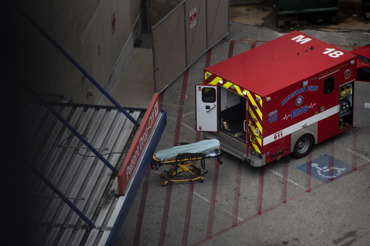 Image: An ambulance sits outside of the emergency room at Houston Methodist Hospital in the Texas Medical Center on July 6, 2020.