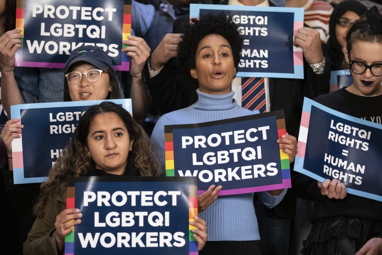 Activists rally in support of LGBTQ rights at City Hall in New York on Oct. 8, 2019.