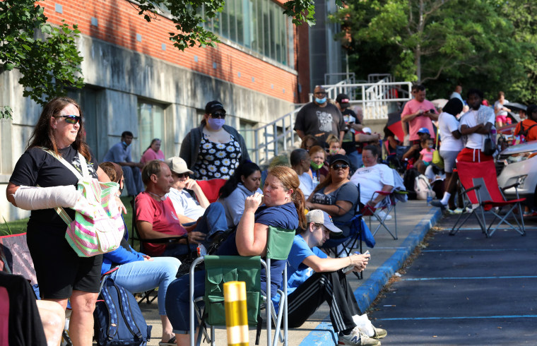 Image: People Wait In Line To File For Unemployment Benefits In Frankfort, Kentucky