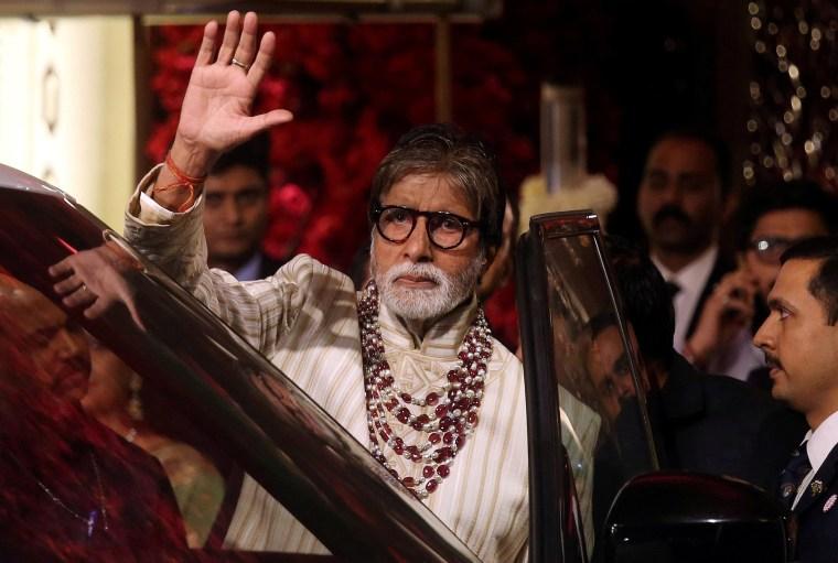Image: Bollywood actor Amitabh Bachchan waving to fans in Mumbai, India