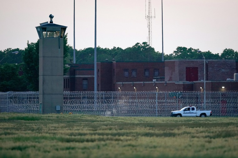 Image: A corrections vehicle patrols near the Federal Corrections Complex in Terre Haute, Indiana.