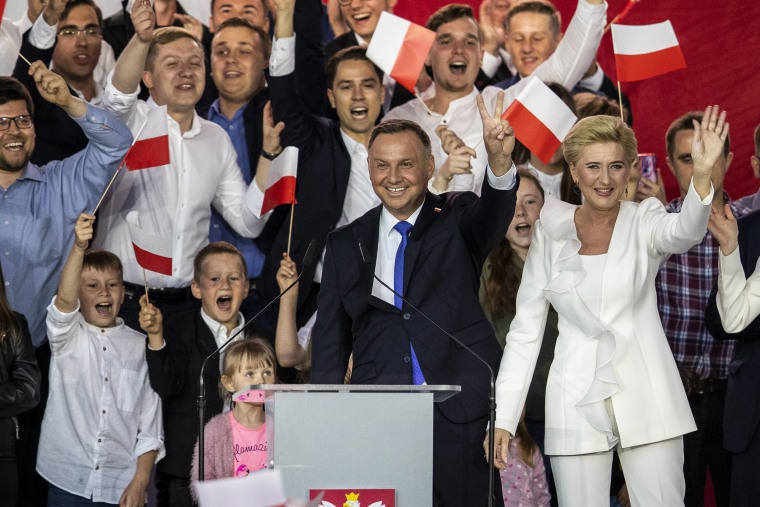 Image: Polish President backed by the right-wing Law and Justice party (PiS), Andrzej Duda and his wife, Agata Kornhauser Duda celebrate with supporters the following initial election results during Polands Presidential elections runoff