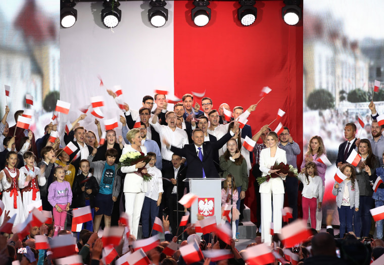 Image: Polish President Andrzej Duda, a conservative who ran a campaign with homophobic and anti-Semitic overtones, celebrates initial election results in Pultusk, Poland