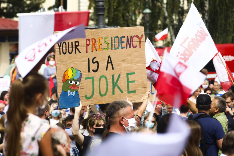 Protesters demonstrate against Polish president Andrzej Duda during his presidential campaign rally in Wieliczka, Poland, on July 9th, 2020.