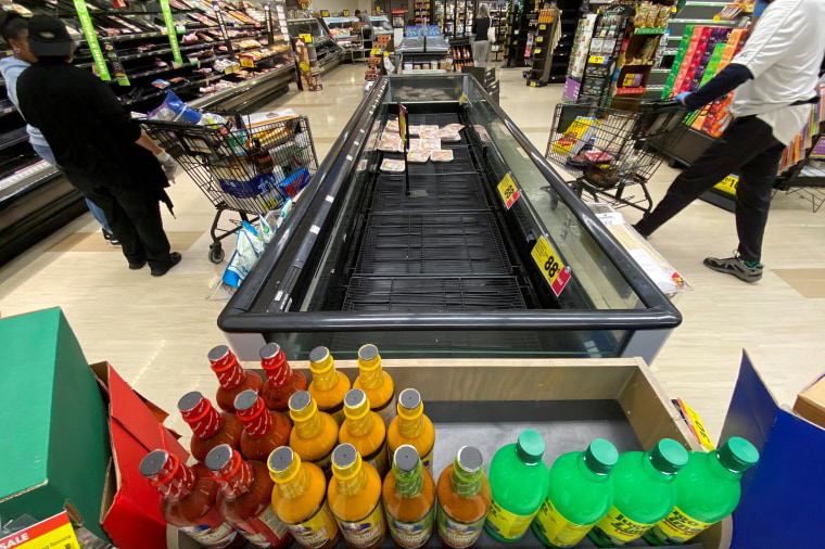 Image: FILE PHOTO: Customers browse grocery store shelves inside Kroger Co.'s Ralphs supermarket amid fears of the global growth of coronavirus cases, in Los Angeles