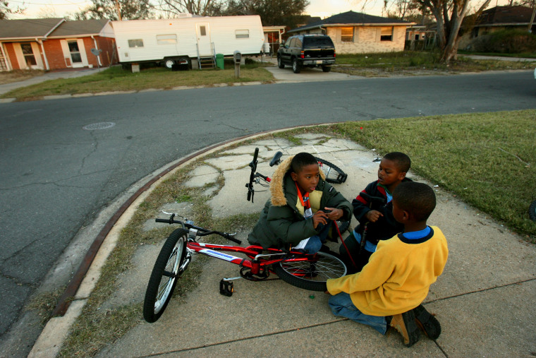Image: A few children have returned to Pontchartrain Park neighborhood with their parents