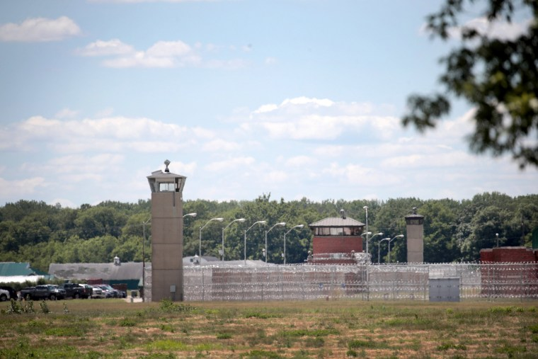Image: A guard tower sits along a security fence at the Federal Correctional Complex where Daniel Lewis Lee is scheduled to be executed on July 13, 2020 in Terre Haute, Indiana.