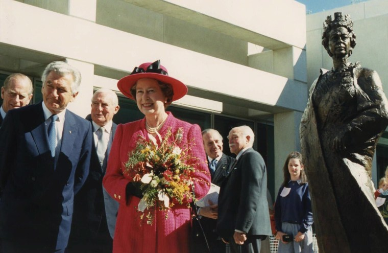 Image: Britain's Queen Elizabeth II smiles after inspecting a statue of herself at Parliament House in Canberra, Australia, in 1988.