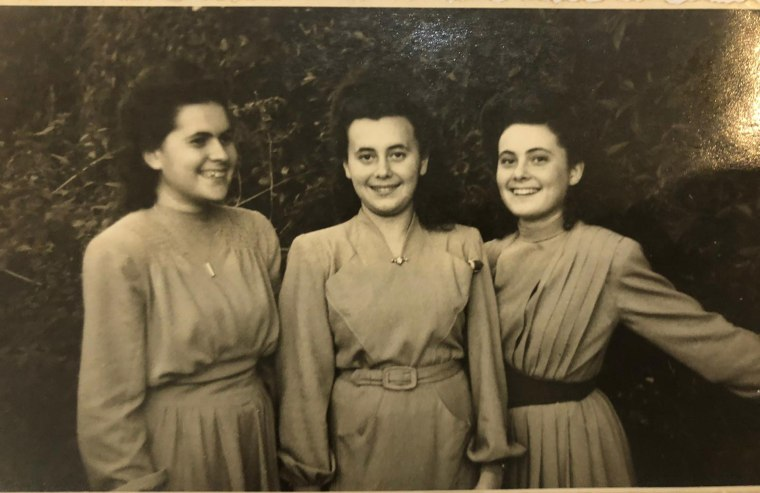 Image: Lily Ebert, center, with her sisters who were sent to Auschwitz together and endured slave labor and the death march during WWII.