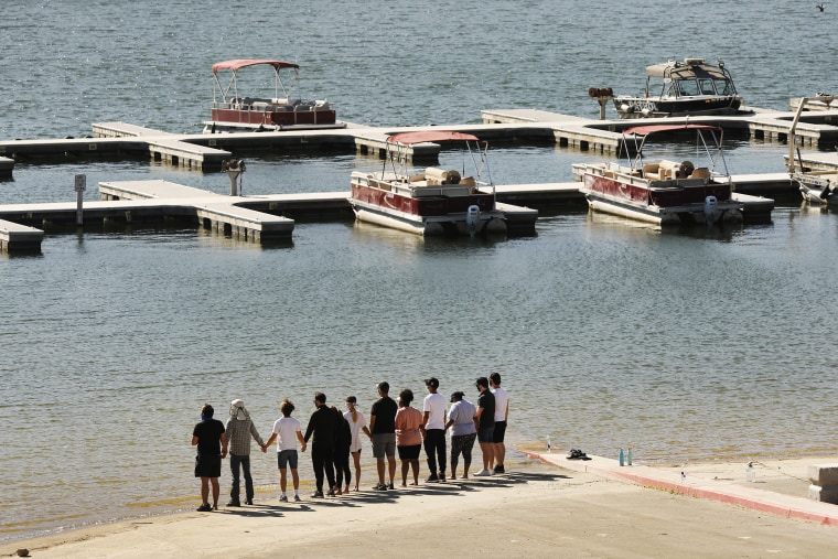 """Image: Cast members from the show """"Glee"""" and friends gathered at the boat launch"""