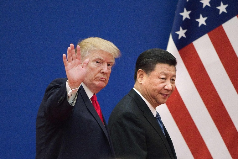 Image: President Donald Trump and China's President Xi Jinping leave a business leaders event at the Great Hall of the People in Beijing.