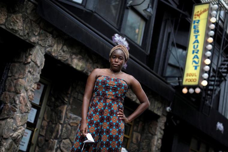 Image: Tren'ness Woods-Black, granddaughter of the late Sylvia Woods, poses outside Sylvia's Restaurant in Harlem in New York