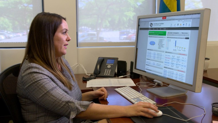 Image: Carly Yoost, CEO of the Child Rescue Coalition, shows the Child Protection System software.