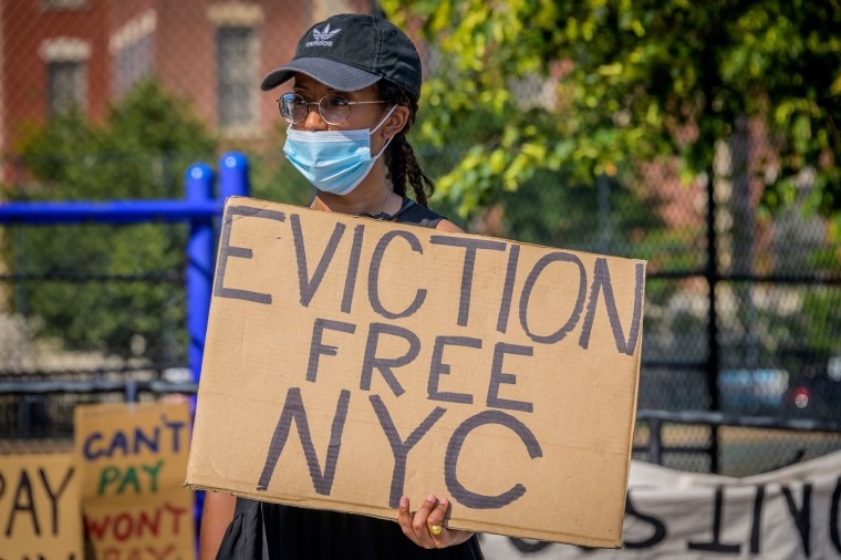 A protester holds a sign against evictions in Brooklyn, New York, on July 5, 2020.