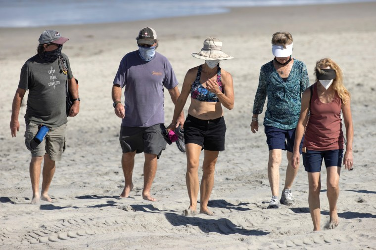 Image: People wear face masks at the beach as California reported its largest number of new coronavirus infections in a single day, during the outbreak of the coronavirus disease (COVID-19) in Del Mar