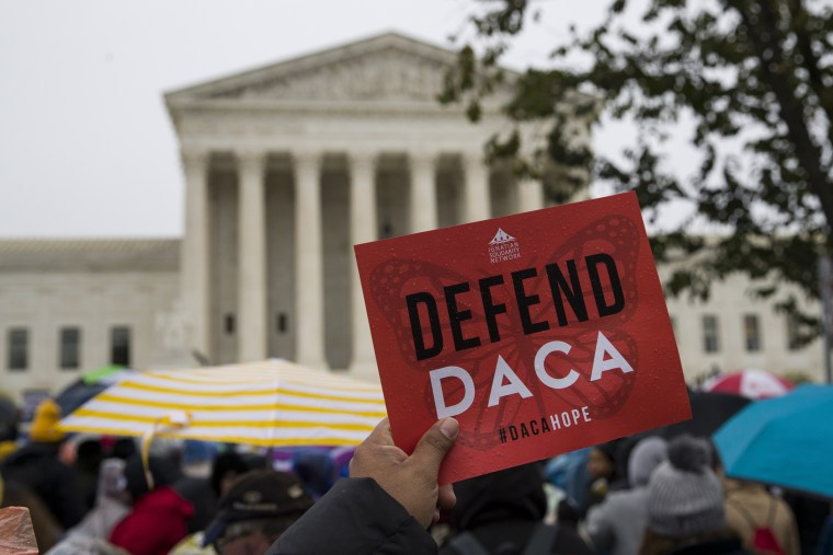 People rally outside the Supreme Court as oral arguments are heard in the case of President Trump's decision to end the Obama-era Deferred Action for Childhood Arrivals program on Nov. 12, 2019.