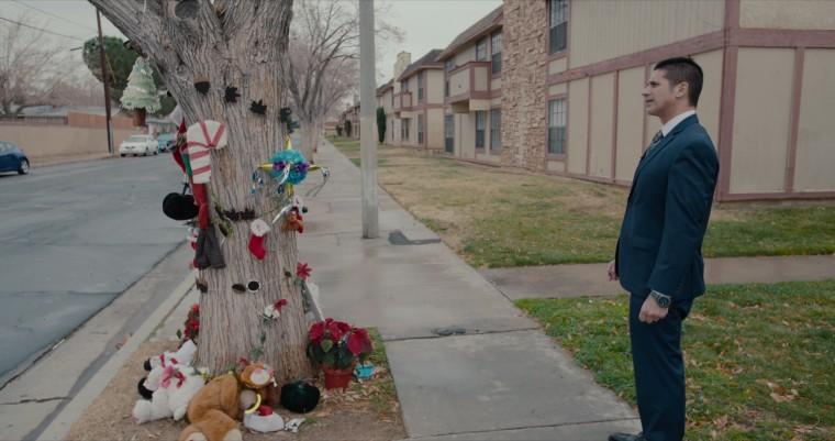"Deputy district attorney John Hatami looks at memorial for Gabriel Fernandez in a scene from the Netflix documentary series \""The Trials of Gabriel Fernandez.\"""