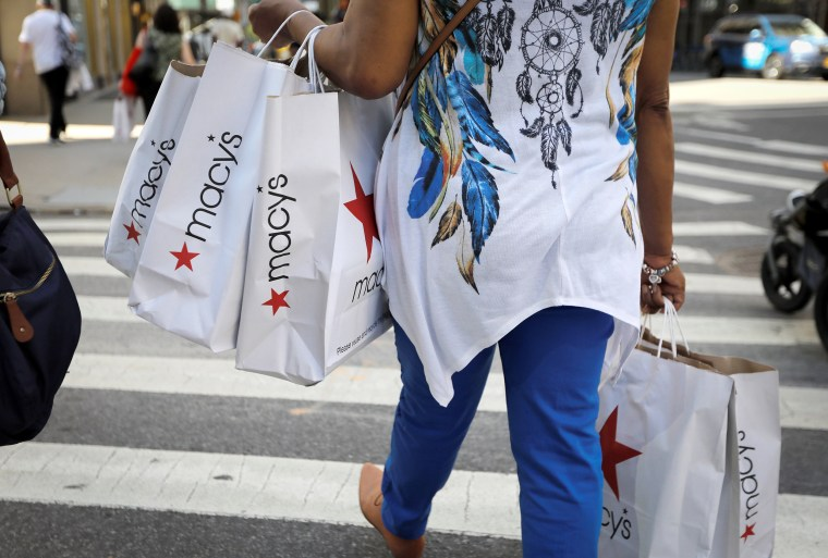 Image: A woman carries shopping bags from Macy's department store in midtown Manhattan in New York