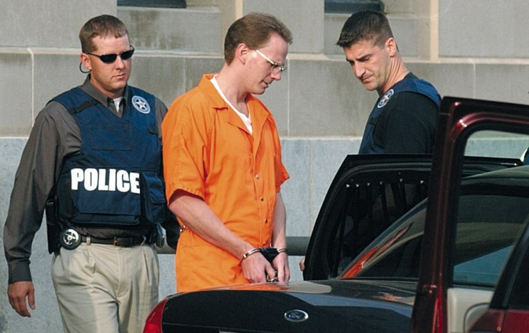 Dustin Honken is led by federal marshals to a waiting car after the second day of jury selection in federal court in Sioux City, Iowa, on Aug. 18, 2004.x