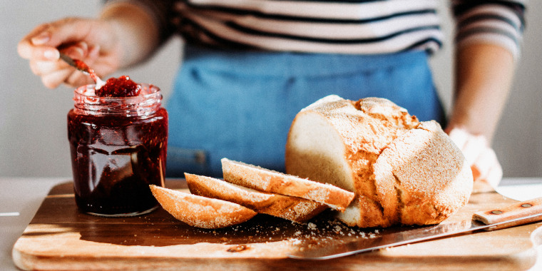 Fresh baked bread served with jam — we've compiled some of the the best bread makers and tools from popular brands including Breville, Cuisinart and KitchenAid.