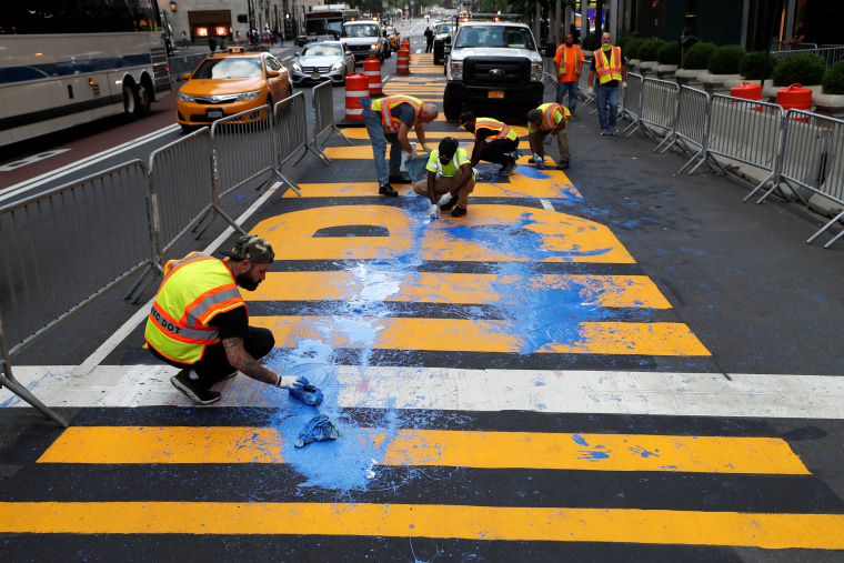 Image: Protesters throw paint on a Black Lives Matter mural outside of Trump Tower on Fifth Avenue in Manhattan, New York