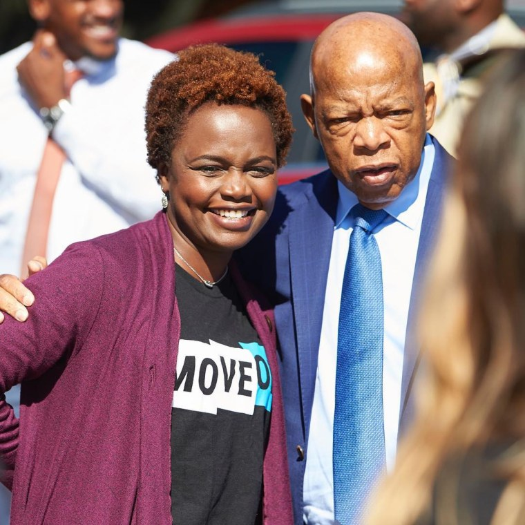 Karine Jean-Pierre and Rep. John Lewis in Dallas, Texas in October 2018.