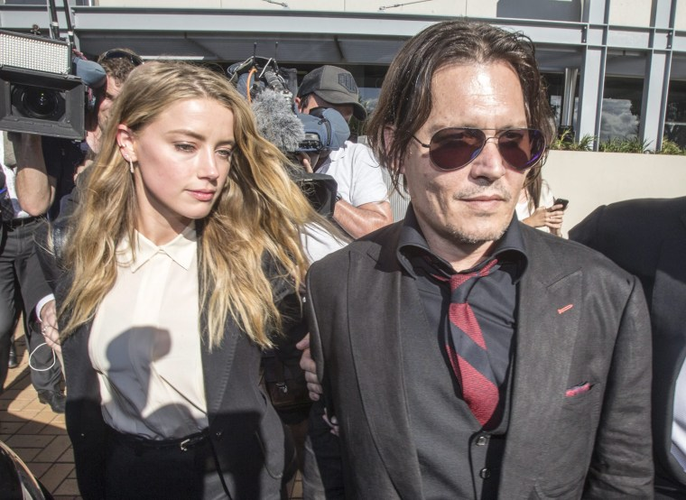 Actor Johnny Depp and Amber Heard leave the Southport Magistrates Court on the Gold Coast of Australia on April 16, 2016.