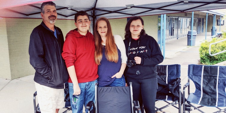 Anthony Lawson, his parents and younger sister at his 14th birthday car parade on May 30, 2020. During Anthony's first weeks home from the hospital, he often became too dizzy and exhausted to walk, so he needed a wheelchair, in the foreground.