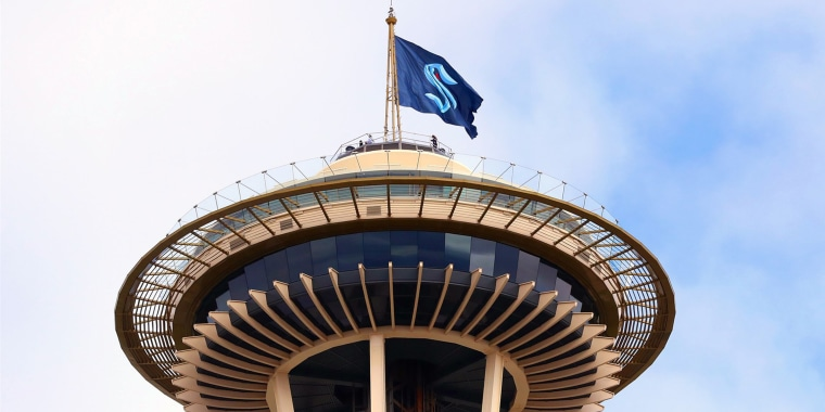 The Seattle Kraken team flag flies above the Space Needle in Seattle on Thursday.