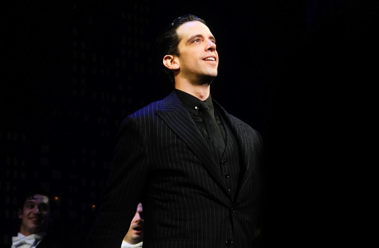 """Image: Nick Cordero performs during the \""""Bullets Over Broadway\"""" opening night curtain call in New York City in 2014."""