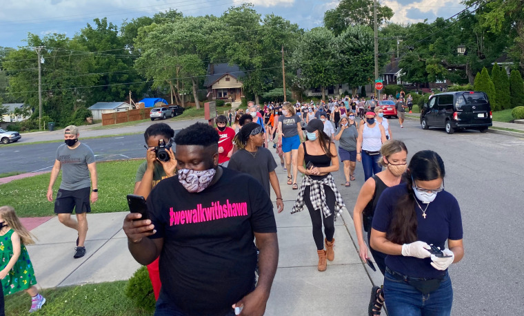 Shawn Dromgoole walks with supporters during one of the nine walks he organized in the greater Nashville area.
