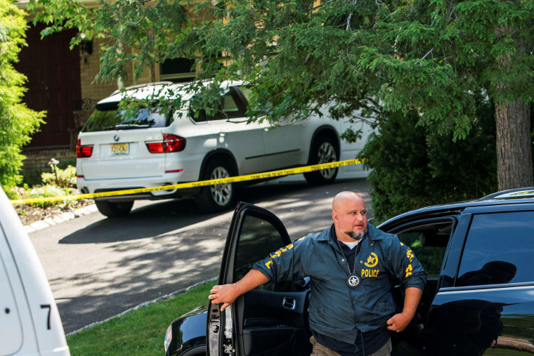 Image: Law enforcement officials are seen outside the home of federal judge Esther Salas in North Brunswick, New Jersey