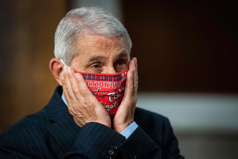 Image: Dr. Anthony Fauci prepares to testify before the Senate Health, Education, Labor and Pensions (HELP) Committee hearing on Capitol Hill.
