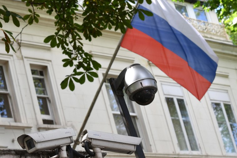 Image: A Russian flag flies by surveillance cameras at the entrance to the Russian consulate in London