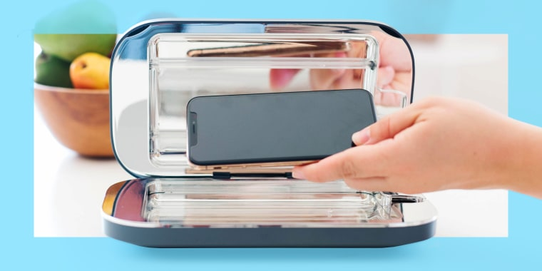 PhoneSoap UV sanitizer on kitchen counter; The best smartphone and other tech UV sanitizers. Brands include PhoneSoap, LARQ, HoMedics and more