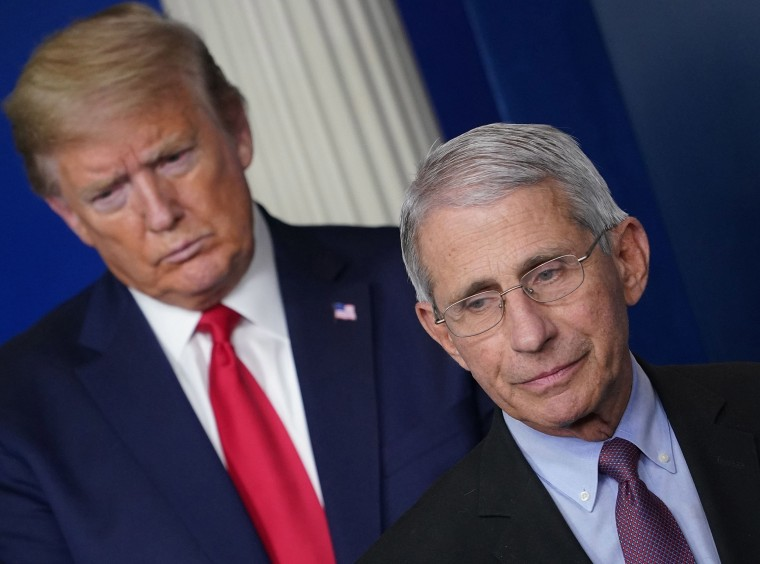 Image: Anthony Fauci, flanked by President Donald Trump, speaks during the daily briefing on the novel coronavirus at the White House