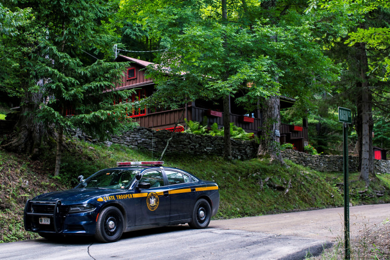 A New York State Trooper stands guard outside the home where attorney Roy Den Hollander was found dead after allegedly killing the son of federal judge Esther Salas and wounding her husband, in Catskills, N.Y., on July 20, 2020.