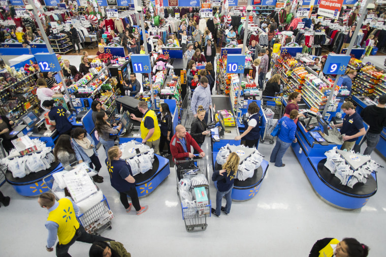 Customers line up in a Walmart store in Bentonville, Ark., with their Black Friday items on Thanksgiving on Nov. 24, 2016.