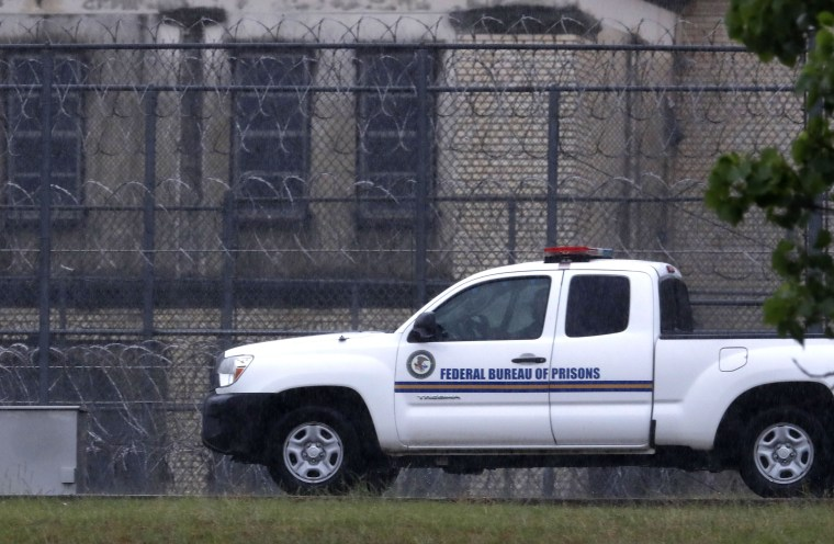 A Federal Bureau of Federal Prisons truck drives past barbed wire fences at the Federal Medical Center prison in Fort Worth, Texas, Saturday, May 16, 2020.